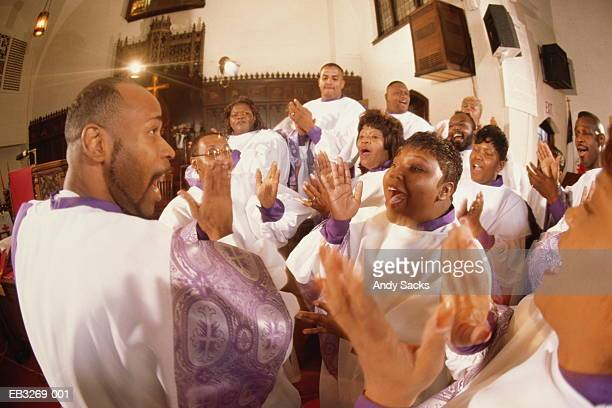 gospel choir singing in church (wide angle) - gospel stock pictures, royalty-free photos & images