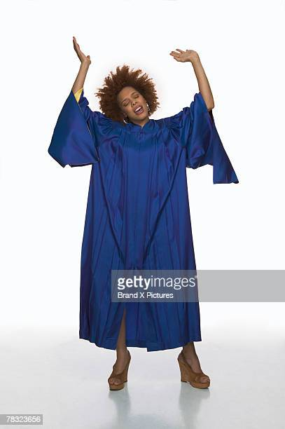 gospel singer in choir robe - gospel stock photos and pictures