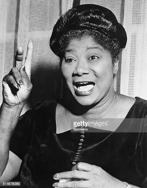 Gospel singer Mahalia Jackson gestures as she sings