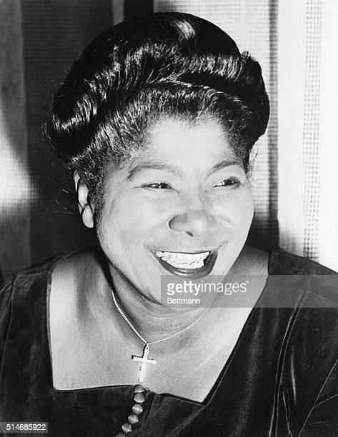 Gospel singer Mahalia Jackson smiles for a portrait