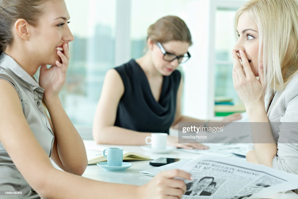 Gossiping in office : Stock Photo