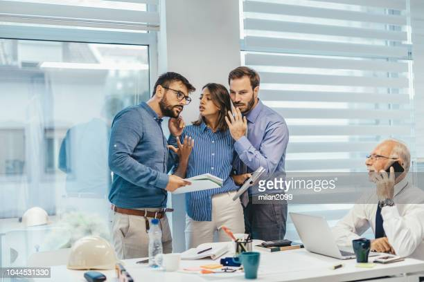 gossiping in the office - gossip stock pictures, royalty-free photos & images