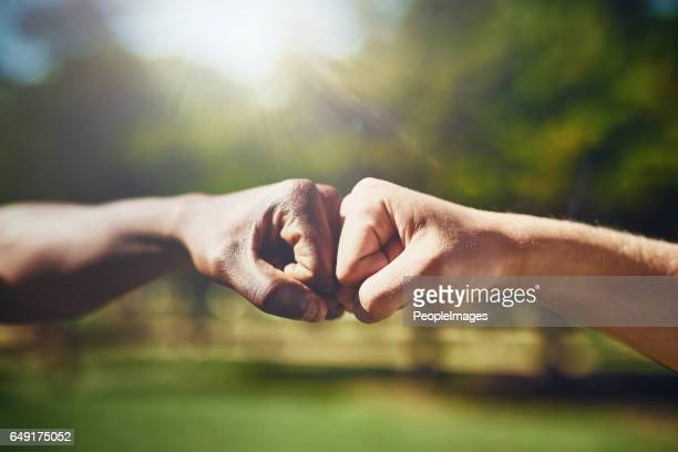 i got you, bro - fist bump stock pictures, royalty-free photos & images