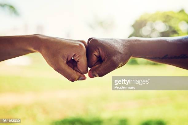 i got you no matter what - fist bump stock pictures, royalty-free photos & images