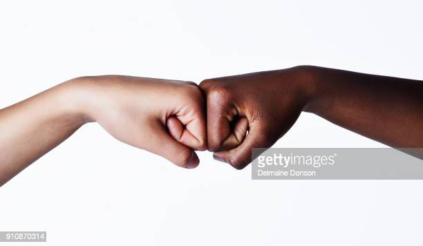i got you, you got me - fist bump stock pictures, royalty-free photos & images