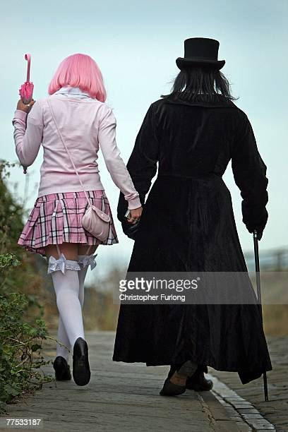 A goth and his girlfriend walk the promenade during Whitby Gothic Weekend on October 26 2007 in Whitby England Whitby Gothic Weekend which started in...