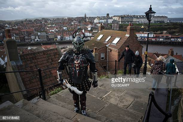 A goth attends the biannual 'Whitby Goth Weekend' festival in Whitby northern England on November 6 2016 The festival brings together thousands of...