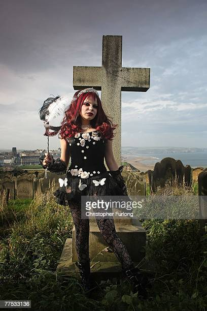 Goth Azadeh poses for a group of photographers during Whitby Gothic Weekend on October 27 2007 in Whitby England Whitby Gothic Weekend which started...
