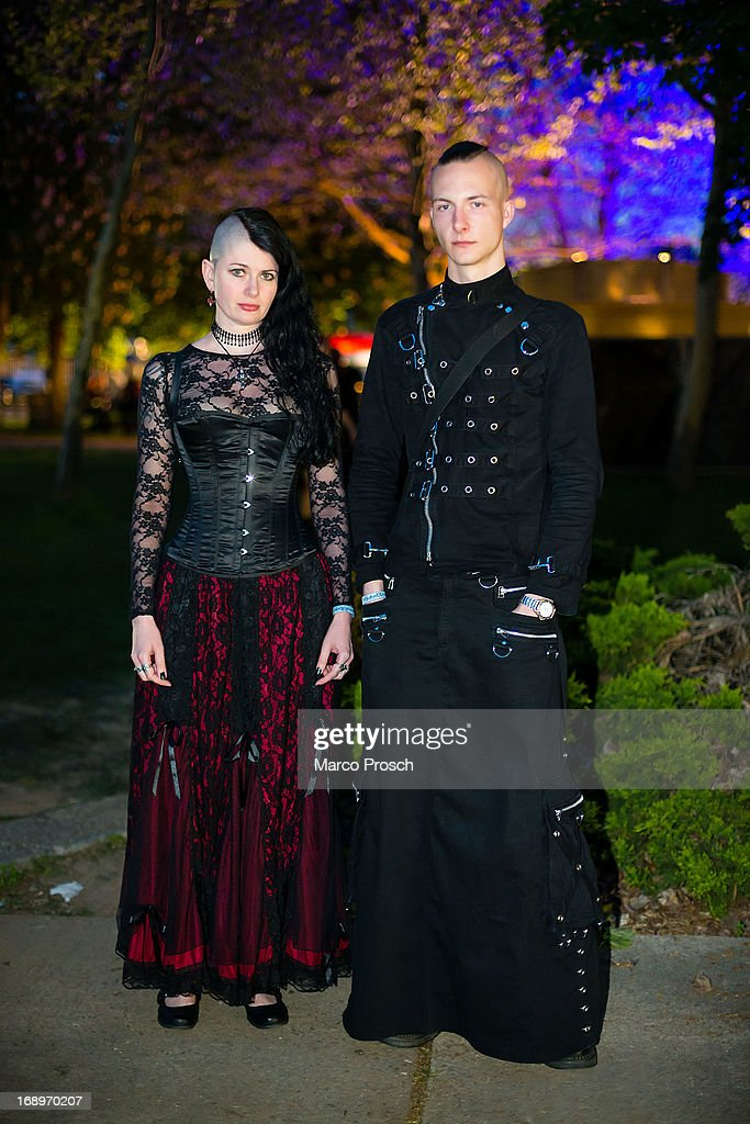 A goth couple poses for pictures at the Agra festival area on the first day of the annual Wave-Gotik Treffen, or Wave and Goth Festival, on May 17, 2013 in Leipzig, Germany. The four-day festival, in which elaborate fashion is a must, brings together over 20,000 Wave, Goth and steam punk enthusiasts from all over the world for concerts, readings, films, a Middle Ages market and workshops.