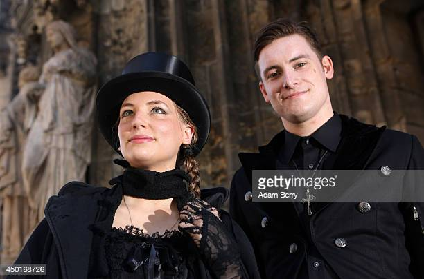 Goth enthusiasts pose during the annual WaveGotikTreffen music festival on June 6 2014 in Leipzig Germany The event began in the 1990s and has since...