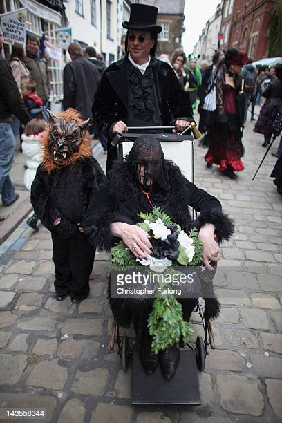 A goth family promenades through the town during the Whitby Goth Weekend on April 28 2012 in Whitby England Whitby Gothic Weekend which started in...