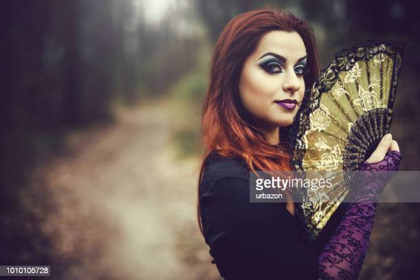 Goth girl with fan