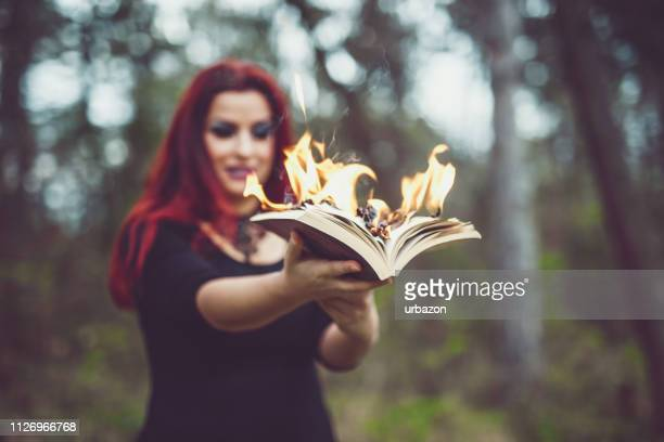 goth girl with pages ablaze - poetry literature stock pictures, royalty-free photos & images