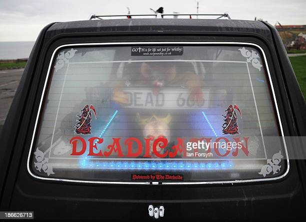 Goth hearse, complete with coffin is parked on a street on November 2, 2013 in Whitby, England. The Whitby Gothic Weekend that takes place in the...