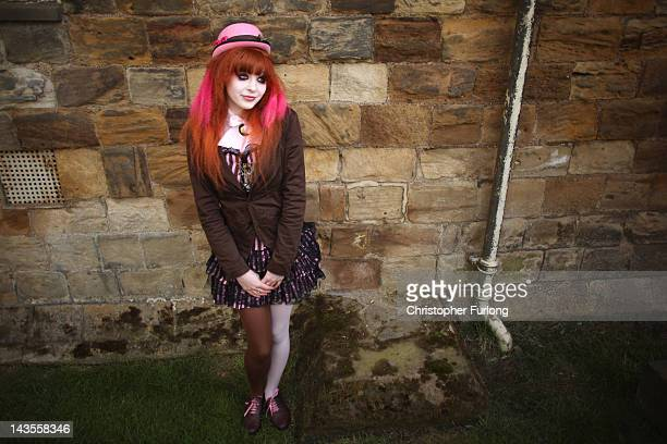 Goth Megan Watt aged 17 poses for photographers during the Whitby Goth Weekend on April 28 2012 in Whitby England Whitby Gothic Weekend which started...