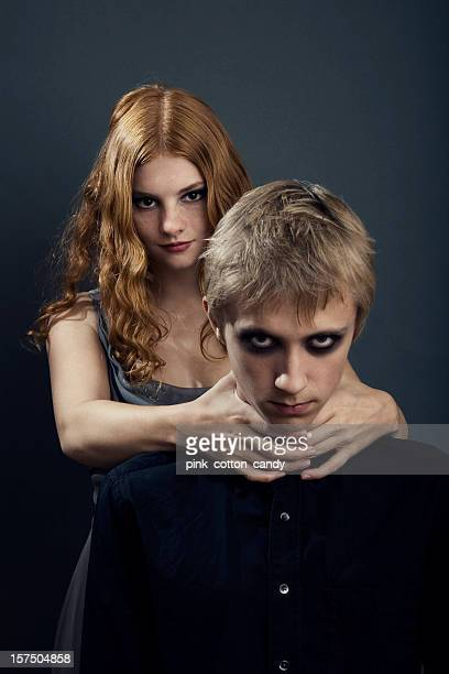 goth teenage girl choking boy - young goth girls stock pictures, royalty-free photos & images