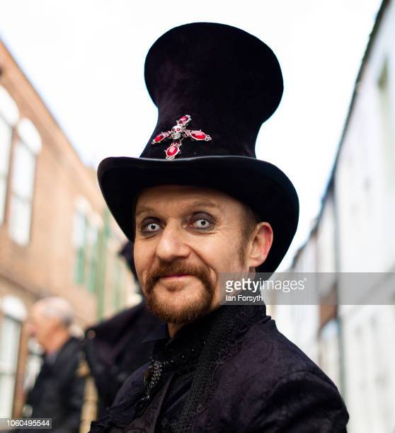 A goth wearing a large top hat poses for a photograph during Whitby Goth Weekend on October 28 2018 in Whitby England Whitby Goth weekend began in...