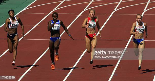 Russia's Yuliya Gushchina competes with Britain's Emma Ania France's Veronique Mang and Autria's Bettina Muller during the Women's 100m qualifying...