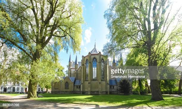 gothic apse of saint mary magdalene and saint catherine church located inside queen astrid park in bruges, flanders, belgium - apse stock photos and pictures