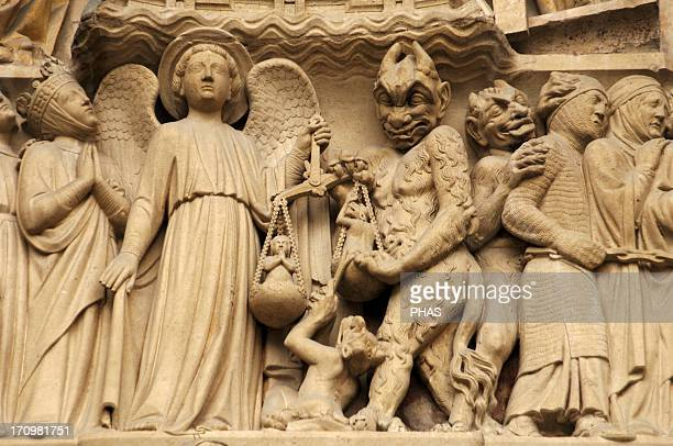 Gothic Art France Paris Notre Dame Sculptures decorating the portal of the Last Judgment It was built in the 1220s1230s Facade The archangel Michael...