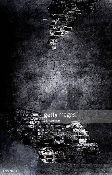 A gothic broken dark black and grey wall