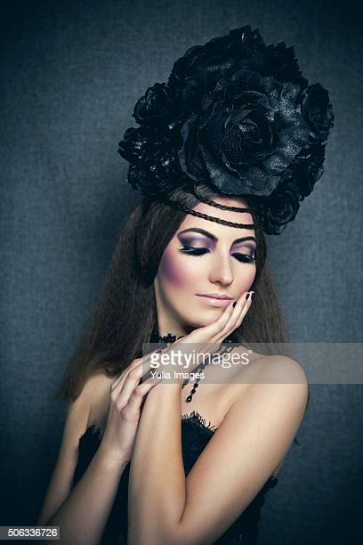 gothic diva with black flower hairdo - fascinator stock pictures, royalty-free photos & images