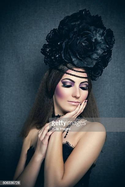 Gothic diva with black flower hairdo