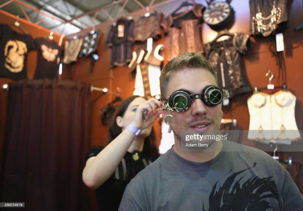 A Gothic enthusiast tries on Steampunk goggles for sale during the annual Wave-Gotik-Treffen (WGT) music festival on June 7, 2014 in Leipzig, Germany. The event began in the 1990s and has since grown into one of the biggest gatherings of Goth scene followers in Europe with around 20,000 participants. Many of those attending wear elaborate outfits and makeup for which they require hours of painstaking preparation and that also show a departure from the traditional black of the Goth scene. Punk remains a strong influence in today's Goth style as witnessed in Leipzig, but newer trends, with names like Cybergoth and Steampunk, have emerged that blend bold colors, Victorian fashion elegance and 19th and 20th century factory accessories into a look reminiscent of a mutated Venetian carnival. The five-day festival includes performances by around 200 bands.