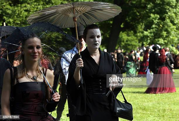 Gothic enthusiasts attend a Victorian picnic during the annual WaveGotikTreffen music festival on June 6 2014 in Leipzig Germany The event began in...