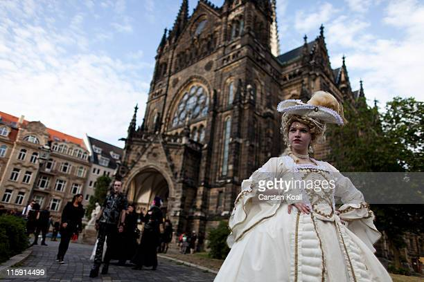 Gothic enthusiasts stand in front of a church after a classic concert during the annual Wave Gotik music festival on June 11 2011 in Leipzig Germany...