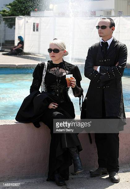 Gothic enthusiasts take a break during the annual WaveGotikTreffen music festival on May 26 2012 in Leipzig Germany The event began in the 1990s and...