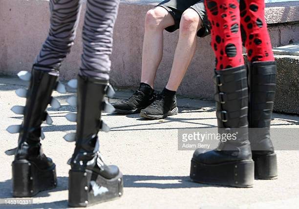 Gothic enthusiasts take a break during the annual Wave-Gotik-Treffen music festival on May 26, 2012 in Leipzig, Germany. The event began in the 1990s...