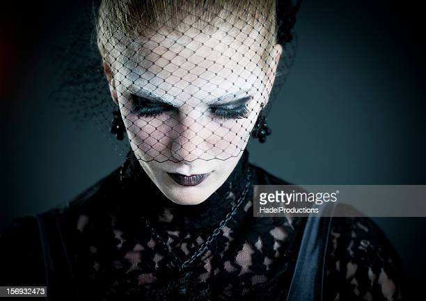 gothic fashion model with a black lace on her eyes - wedding veil stock photos and pictures
