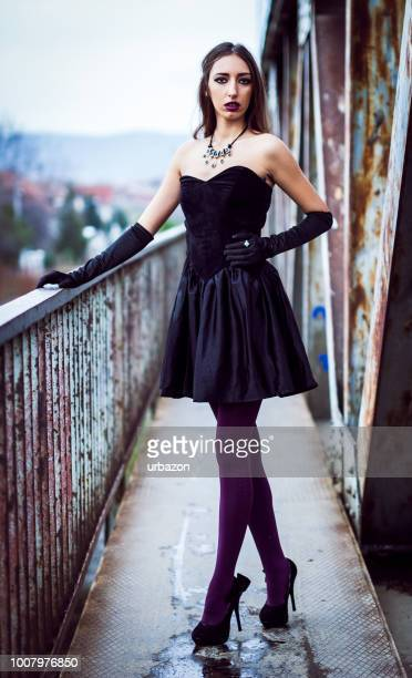 gothic girl on grunge bridge - hot dirty girl stock photos and pictures