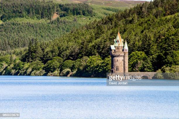 gothic revival tower at lake vyrnwy, wales, uk - lake vyrnwy stock pictures, royalty-free photos & images