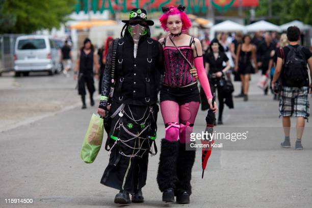 Gothic rock music enthusiasts walk the streets between venues during the annual Wave Gotik music festival on June 11 2011 in Leipzig Germany The...