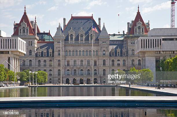 gothic-style building behind reflecting pools - ニューヨーク州庁舎 ストックフォトと画像
