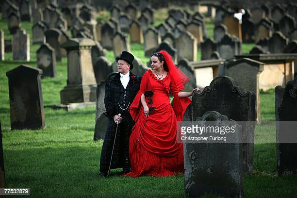 Goths Tony and Angela Lightowler pose for wedding pictures after renewing their marriage vows at St Mary The Virgin Church during Whitby Gothic...