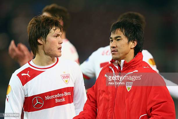 Gotoku Sakai and Shinji Okazaki of Stuttgart shake hands after the UEFA Europa League group E match between VfB Stuttgart and Molde FK at...