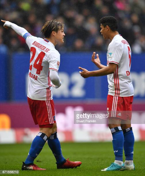 Gotoku Sakai gestures to Douglas of Hamburg during the Bundesliga match between Hamburger SV and SV Darmstadt 98 at Volksparkstadion on April 22 2017...