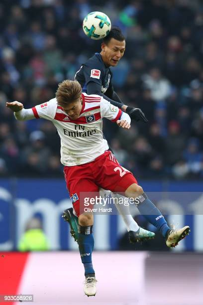 Gotoku Sakai of Hamburg and Davie Selke of Berlin compete for the ball during the Bundesliga match between Hamburger SV and Hertha BSC at...