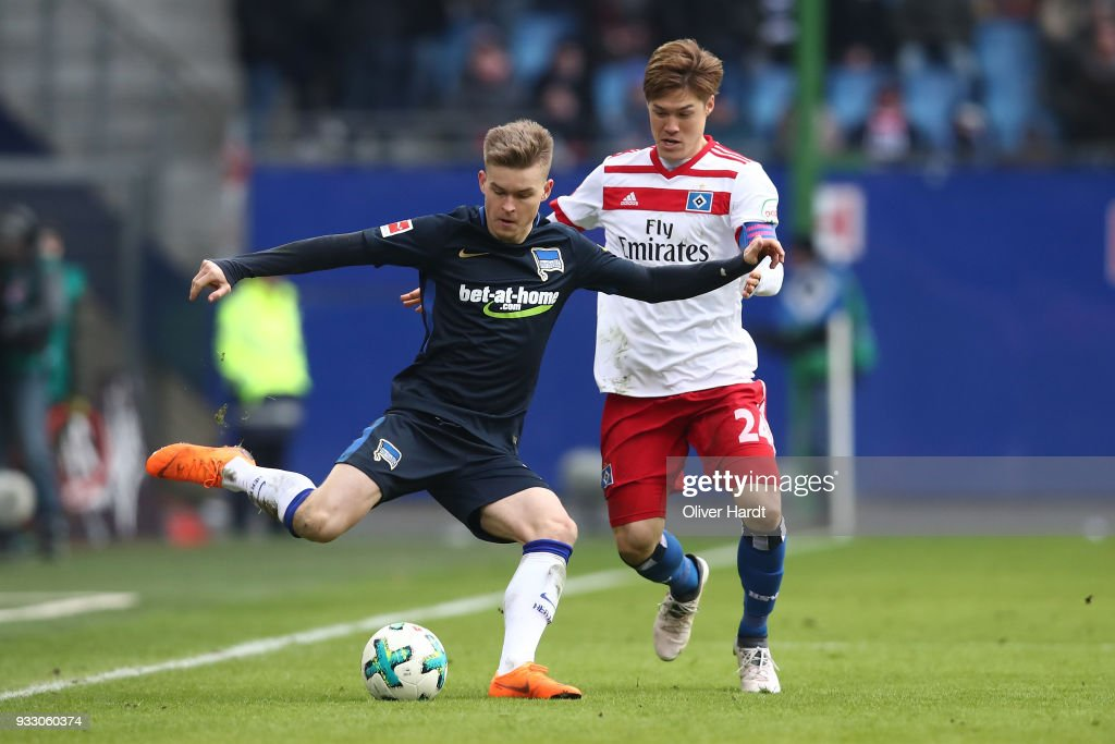 Gotoku Sakai (R) of Hamburg and Maximilian Mittelstaedt (L) of Berlin compete for the ball during the Bundesliga match between Hamburger SV and Hertha BSC at Volksparkstadion on March 17, 2018 in Hamburg, Germany.