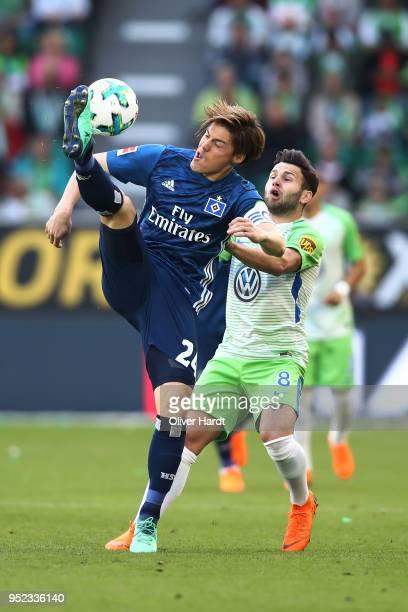 Gotoku Sakai of Hamburg and Renato Steffen of Wolfsburg compete for the ball during the Bundesliga match between VfL Wolfsburg and Hamburger SV at...