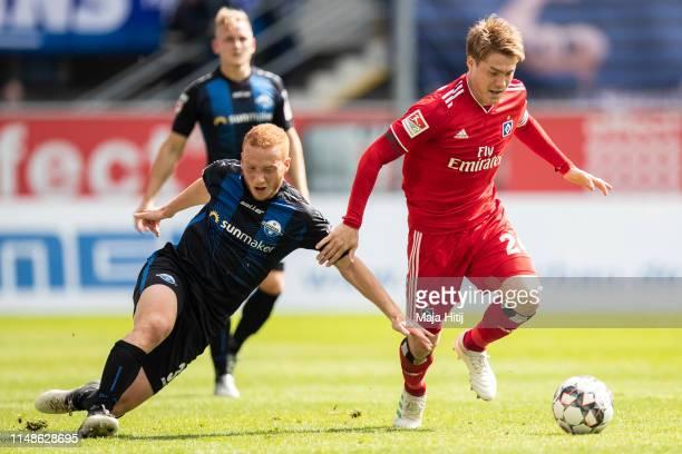 Gotoku Sakai of Hamburg and Sebastian Vasiliadis of SC Paderborn battle for possession during the Second Bundesliga match between SC Paderborn 07 and...