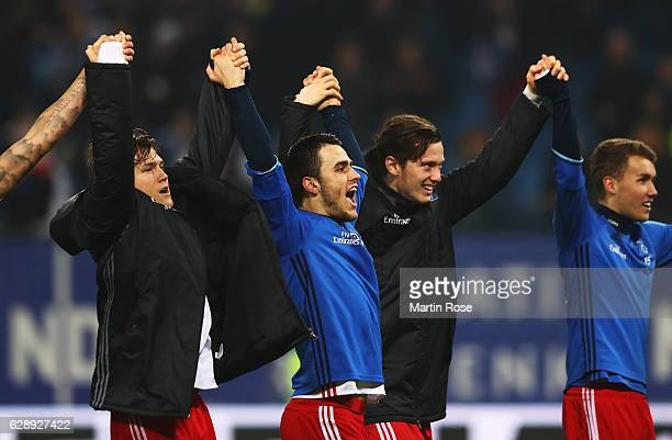 Gotoku Sakai of Hamburg celebrates with teamates their win at the end of the Bundesliga match between Hamburger SV and FC Augsburg at...