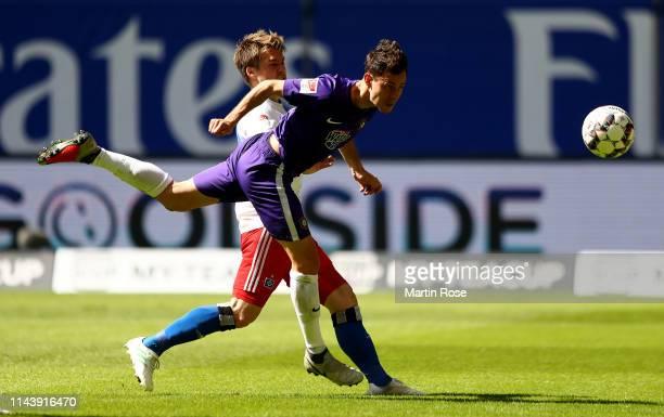 Gotoku Sakai of Hamburg challenges Clemens Fandrich of Aue during the Second Bundesliga match between Hamburger SV and FC Erzgebirge Aue at...