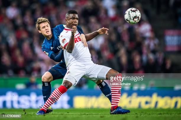 Gotoku Sakai of Hamburg challenges for the ball with Jhon Cordoba of Köln during the Second Bundesliga match between 1 FC Koeln and Hamburger SV at...