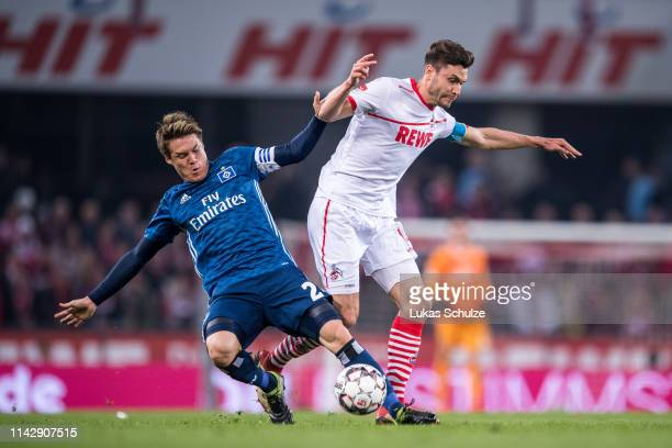 Gotoku Sakai of Hamburg challenges for the ball with Jonas Hector of Köln during the Second Bundesliga match between 1 FC Koeln and Hamburger SV at...