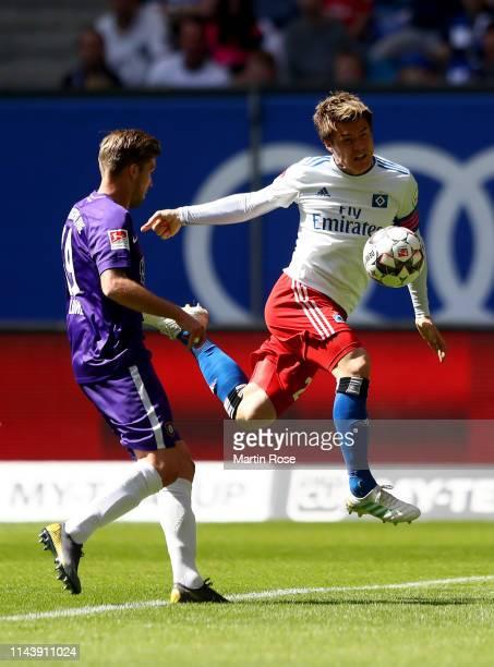 Gotoku Sakai of Hamburg challenges Philipp Zulechner of Aue during the Second Bundesliga match between Hamburger SV and FC Erzgebirge Aue at...