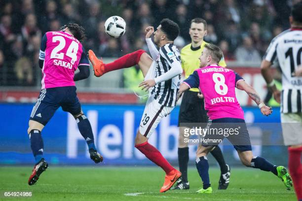 Gotoku Sakai of Hamburg is challenged by Omar Mascarell of Frankfurt during the Bundesliga match between Eintracht Frankfurt and Hamburger SV at...